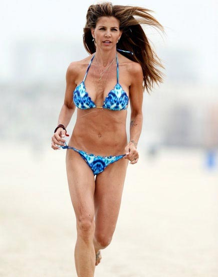 With her slim body and Dark brown hairtype without bra (cup size 36C) on the beach in bikini